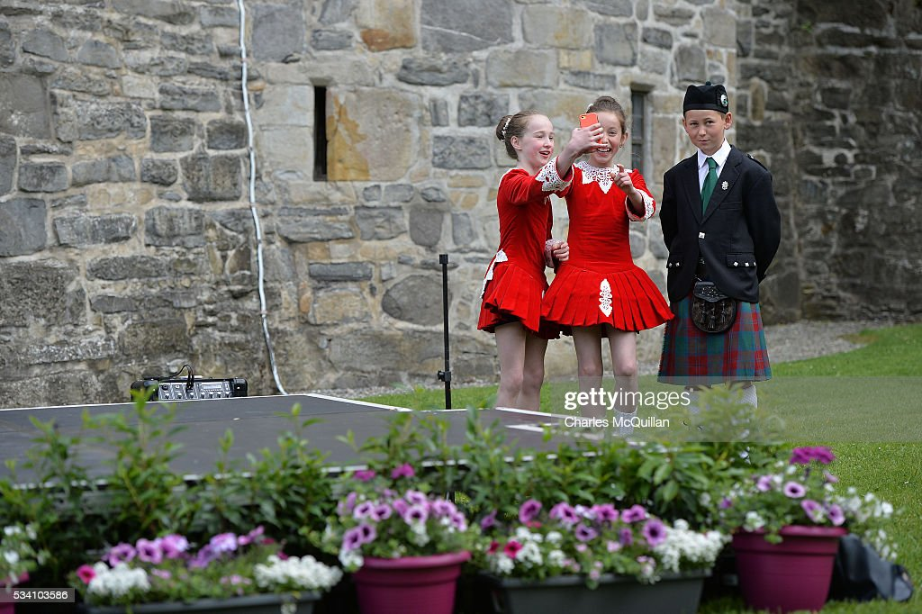 Irish dancers due to perform for Prince Charles, Prince of Wales and Camilla, Duchess of Cornwall take selfies on a smartphone before the royal couple arrive to visit to Donegal Castle on May 25, 2016 in Letterkenny, Ireland. The royal couple are on a one day visit to Ireland having spent two days across the border in Northern Ireland. It is their first trip to Donegal.