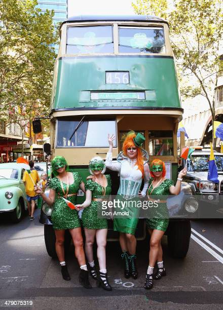 Irish Drag Queen Peachy Queen poses alongside supporters and prepares to march in the St Patrick's day parade on behalf of all gay lesbian bisexual...