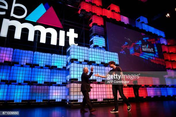 Irish entrepreneur and Web Summit cofounder Paddy Cosgrave welcomes Portuguese Prime Minister Antonio Costa on stage during the opening ceremony of...