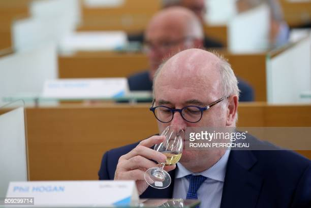 Irish European Commissioner for Agriculture and Rural Development Phil Hogan smells a glass of white wine during his visit to Institut Superieur de...