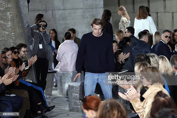 Irish fashion designer JW Anderson acknowledges the public at the end of Loewe 2016 Spring/Summer readytowear collection fashion show on October 2...