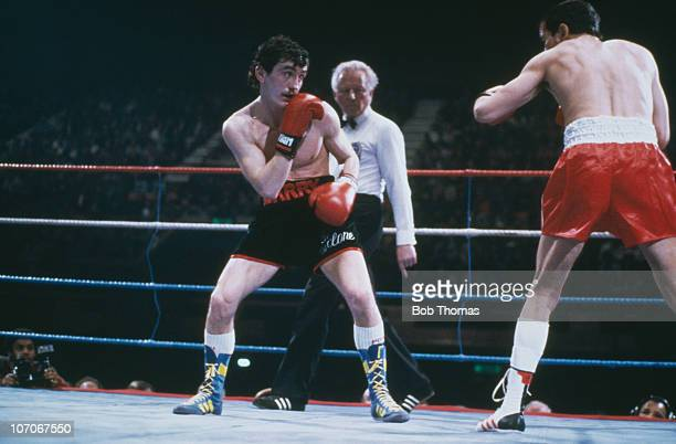 Irish featherweight boxer Barry McGuigan defends his European title against Farid Gallouze of France at Wembley Arena London 26th March 1985 McGuigan...