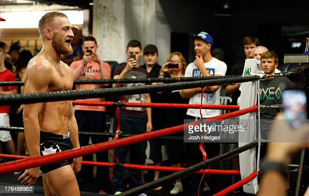 Irish featherweight Conor McGregor interacts with fans during an open training session for media at Peter Welch's Boxing Gym on August 13 2013 in...
