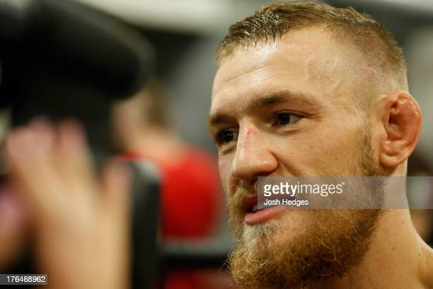 Irish featherweight Conor McGregor interacts with media after holding an open training session at Peter Welch's Boxing Gym on August 13 2013 in...