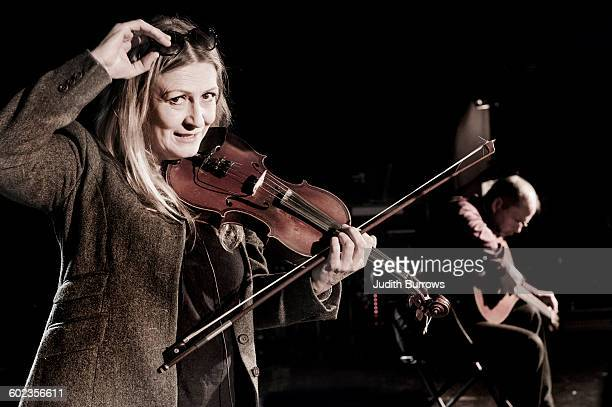 Irish fiddler and singer Mairéad Ní Mhaonaigh and musician Martin Tourish of Irish folk band Altan at Sidmouth Folk Week in Sidmouth Devon UK 1st...