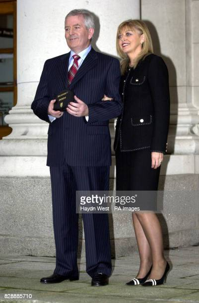 Irish Finance Minister Charlie McCreevy with his wife Noleen outside Government Buildings in Dublin Ireland with two CDs containing the Irish Budget...