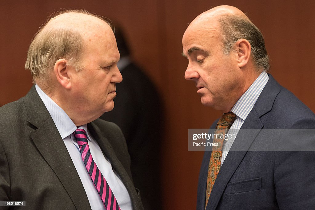 Irish Finance Minister <a gi-track='captionPersonalityLinkClicked' href=/galleries/search?phrase=Michael+Noonan&family=editorial&specificpeople=7554249 ng-click='$event.stopPropagation()'>Michael Noonan</a> (L) and Spanish Economy minister Cristobal Montoro Romero (R) speak to each other at the start of the Eurogroup meeting. The Eurogroup finance Ministers will discuss the draft budgetary plans for 2016 of euro area member states, on the basis of the European Commission's opinions.Cyprus and Greece do not need to submit draft budgetary plans, Portugal has not yet submitted its plan.