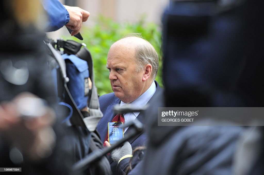 Irish Finance minister Michael Noonan answers the media upon his arrival on November 26, 2012 prior to an Eurozone meeting at the EU Headquarters in Brussels. Eurozone finance ministers and other creditors of Greece as IMF and ECB meet for the third time in two weeks on immediate funding to avert a threat of bankruptcy for Greece and to deal with the country's ever-growing mountain of debt.