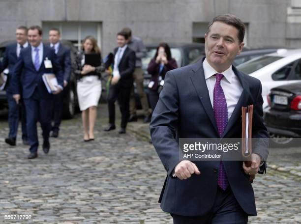 Irish Finance Minister Paschal Donohoe emerges from his office at Goverment Buildings for a photocall with the 2018 budget in Dublin Ireland on...