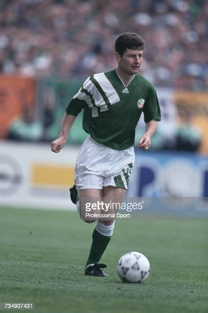 Irish footballer and defender with the Republic of Ireland team Denis Irwin pictured making a run with the ball during the FIFA World Cup group 3...