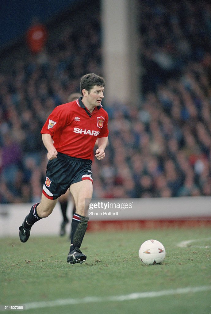 Irish footballer <a gi-track='captionPersonalityLinkClicked' href=/galleries/search?phrase=Denis+Irwin&family=editorial&specificpeople=221637 ng-click='$event.stopPropagation()'>Denis Irwin</a> playing for Manchester United against Manchester City, in an English Premier League match at Maine Road, Manchester, 11th February 1995. United won the match 3-0.