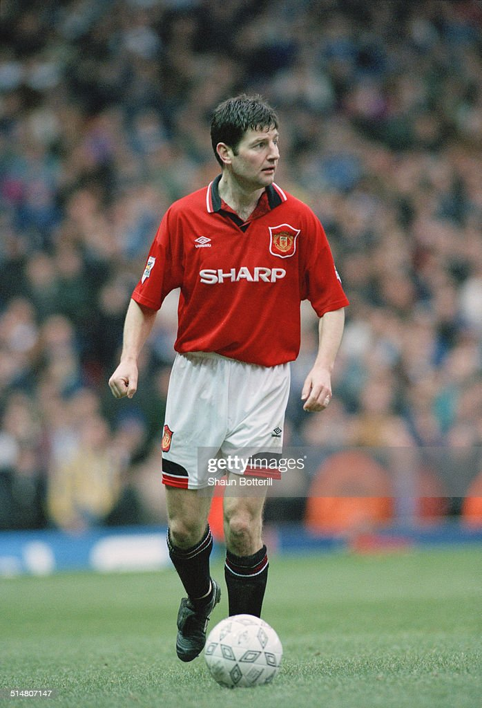 Irish footballer <a gi-track='captionPersonalityLinkClicked' href=/galleries/search?phrase=Denis+Irwin&family=editorial&specificpeople=221637 ng-click='$event.stopPropagation()'>Denis Irwin</a> playing for Manchester United against Leeds United, in an English FA Cup Fifth Round match at Old Trafford, Manchester, 19th February 1995. Manchester United won the match 3-1.