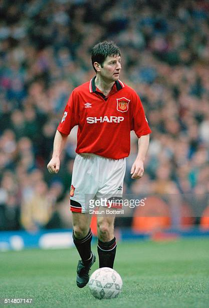 Irish footballer Denis Irwin playing for Manchester United against Leeds United in an English FA Cup Fifth Round match at Old Trafford Manchester...