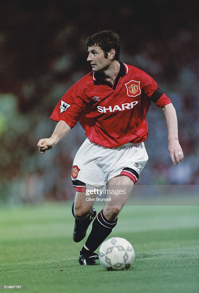 Irish footballer <a gi-track='captionPersonalityLinkClicked' href=/galleries/search?phrase=Denis+Irwin&family=editorial&specificpeople=221637 ng-click='$event.stopPropagation()'>Denis Irwin</a> playing for Manchester United against West Ham, in an English Premier League match at Old Trafford, Manchester, 23rd August 1995. Manchester United won the match 2-1.