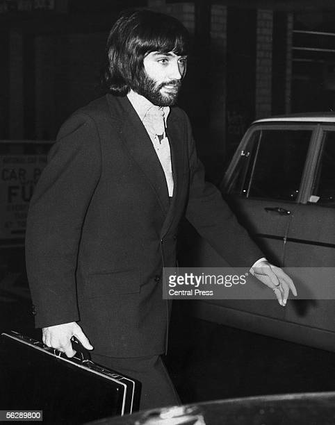 Irish footballer George Best of Manchester United arrives at Euston Station in London en route to a disciplinary hearing at the Cavendish Hotel in...