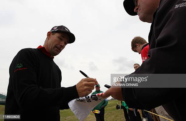 Irish golfer Padraig Harrington signs autographs during practice ahead of the 140th British Open Golf championship at Royal St George's in Sandwich...