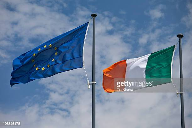 Irish green white and gold stripes flag and and European Union EU blue flag with gold stars in County Clare Ireland