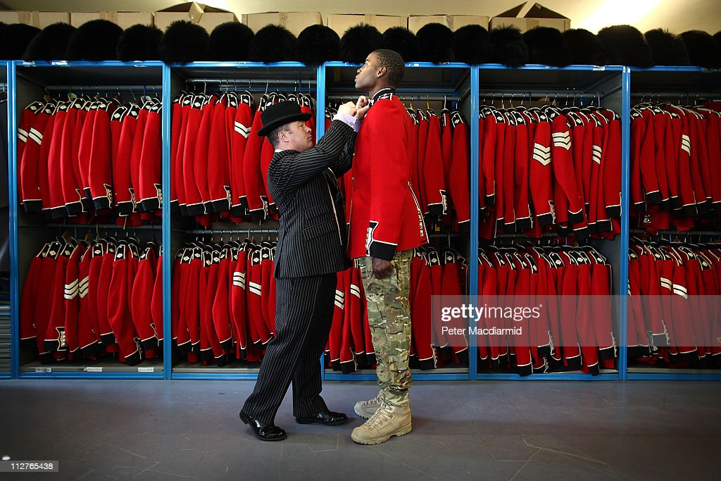 Irish Guardsman Bortnill St'Ange is fitted with his ceremonial uniform by Master Tailor Lance Sergeant Matthew Else in the store room at Victoria Barracks on April 21, 2011 in Windsor, England. The Irish Guards returned from active duty in Afghanistan at the beginning of April, and are now preparing for ceremonial duties. Prince William is the Colonel of the Regiment and the Irish Guards will be on duty at the Royal Wedding on April 29, 2011.