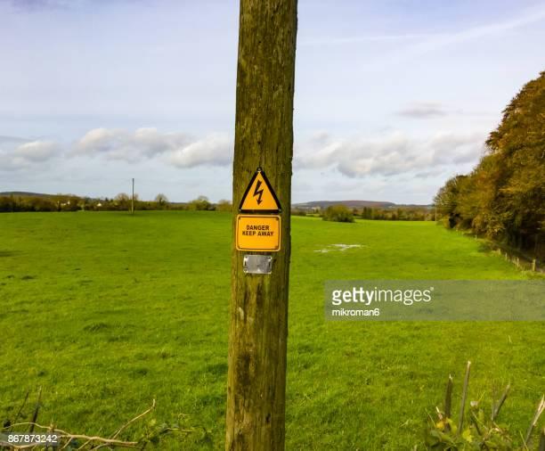 Irish high voltage sign mounted on wooden pole