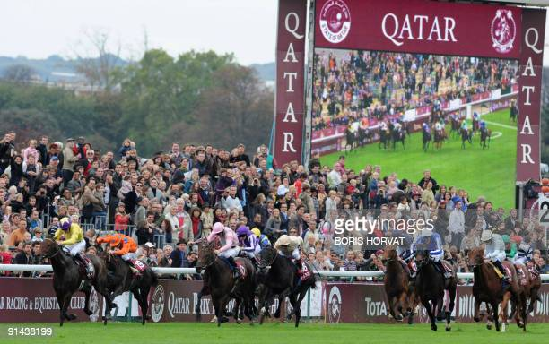 Irish jockey Mickael Kinane competes on 'Sea the Stars' along with other jockeys during the 88th edition of the Arc de Triomphe prize at the...