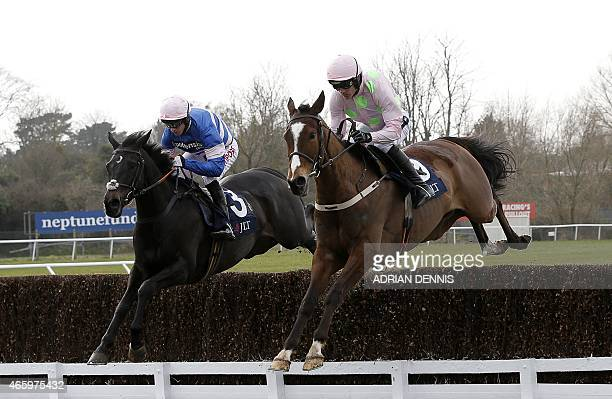 Irish jockey Ruby Walsh riding Vautour jumps a fence on his way to winning the The JLT Novices' Steeple Chase on the third day of the Cheltenham...