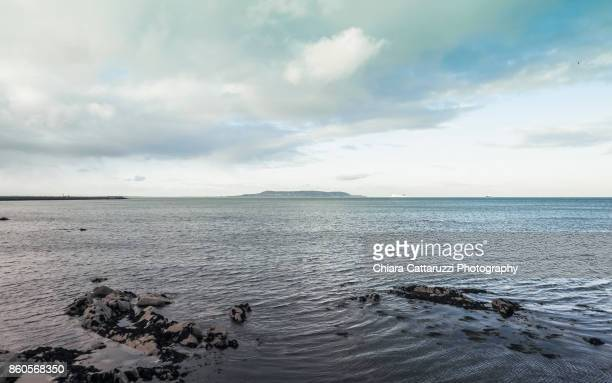 Irish landscape with rocks in the blue sea