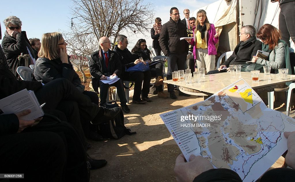 Irish Martina Anderson (3rd R), a member of the European Parliament, leads delegation of European MPs during a visit to the Palestinian village of Susya, south-east of Hebron, in the Israeli-occupied West Bank, on February 10, 2016. Israel's High Court ruled in May 2015 that Susya's 340 residents could be relocated and its structures demolished, which Human Rights Watch derided as 'a grave breach' of Israel's obligations to the Palestinian populace under its military rule. / AFP / HAZEM BADER