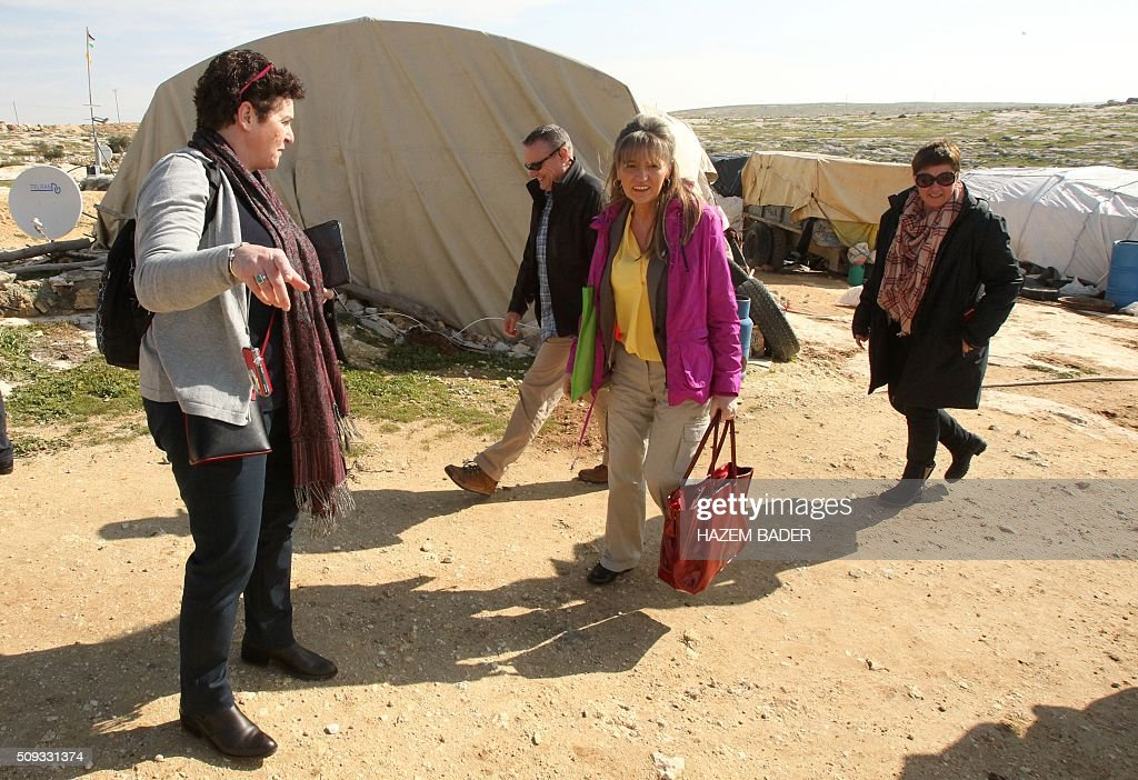 Irish Martina Anderson (2n R), a member of the European Parliament, leads delegation of European MPs during a visit to the Palestinian village of Susya, south-east of Hebron, in the Israeli-occupied West Bank, on February 10, 2016. Israel's High Court ruled in May 2015 that Susya's 340 residents could be relocated and its structures demolished, which Human Rights Watch derided as 'a grave breach' of Israel's obligations to the Palestinian populace under its military rule. / AFP / HAZEM BADER