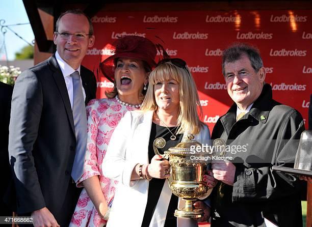 Irish Minister for Agriculture Simon Coveney Noreen McManus Jessica Harrington and JP McManus after their Jockey Mark Walsh on Jezki won the fourth...