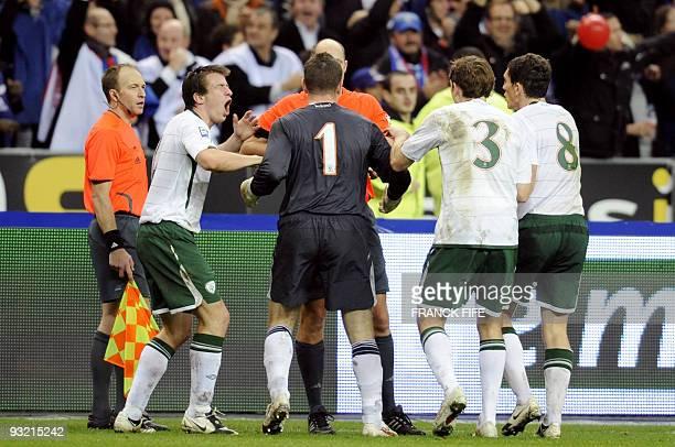 Irish national football team goalkeeper Shay Given defender Richard Dunne and midfielder Keith Andrews speak with Swedish referee Martin Hansson...