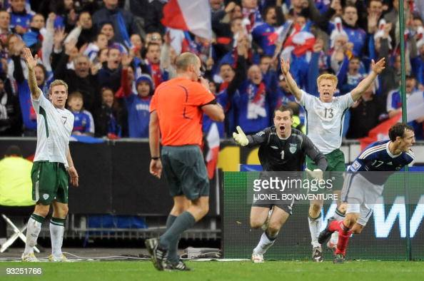 Irish national football team midfielder Liam Lawrence goalkeeper Given and defender Paul Mc Shane shout to Swedish referee Martin Hansson as French...