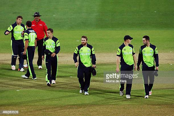 Irish players come from the field after the 2015 ICC Cricket World Cup match between Pakistan and Ireland at Adelaide Oval on March 15 2015 in...