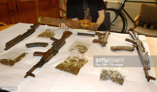 Irish Police put on show a cache of weapons found at Drumkeen in Co Donegal in the Irish Republic which are thought to belong to dissident terrorists...