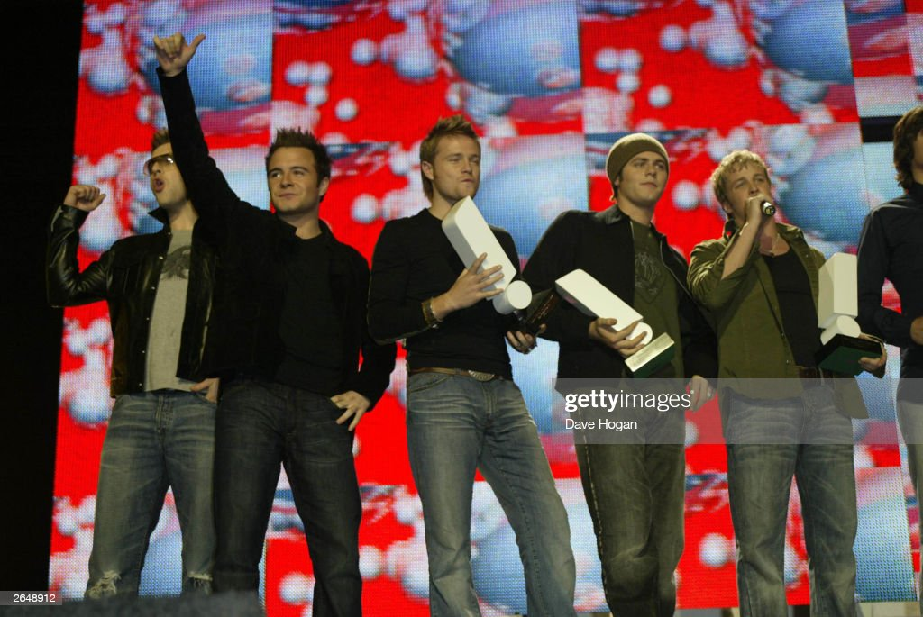 Irish pop group 'Westlife' recieve an award at the Smash Hits Poll Winners Party 2002 at the London Docklands Arena on November 24, 2002 in London.