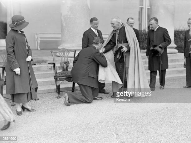 Irish President Eamon de Valera receiving the Archbishop of Dublin during the State Garden Party for the delegates of the World Education Conference...