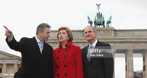 Irish President Mary McAleese and her husband Martin McAleese chat with Berlin mayor Klaus Wowereit in front of the Brandenburg Gate during a brief...