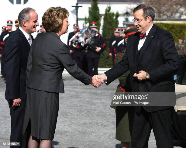 Irish President Mary McAleese centre and her husband Martin left welcome the President of Estonia Toomas Hendrik Ilves right to Aras an Uachtarain as...