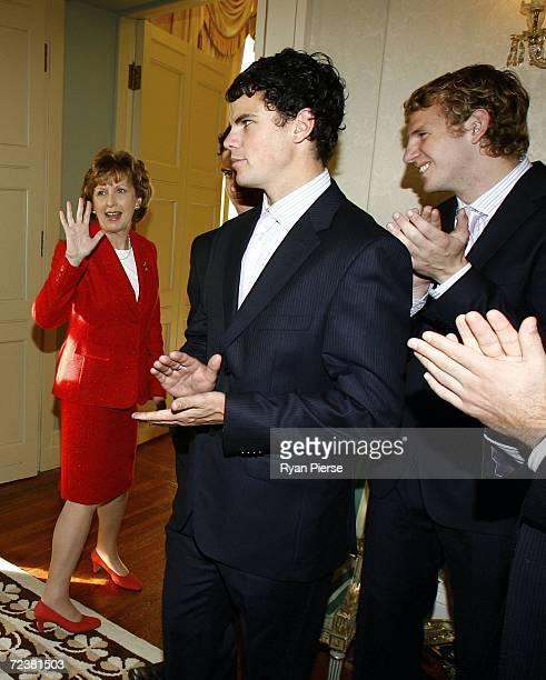 Irish President Mary McAleese waves farewell to Australian players Brett Peake and David Mundy during the Australian International Rules team visit...