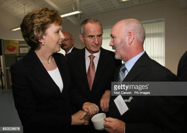 Irish president Mary McAleese with husband Dr Martin McAleese talks to Sinn Fein's Alex Maskey in Finaghy Library in Belfast where she also met...