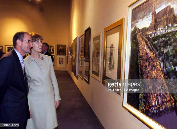Irish President Mary McAleese with husband Martin admire a painting of Orangemen gathered at Drumcree church by artist JMcWilliams The president was...