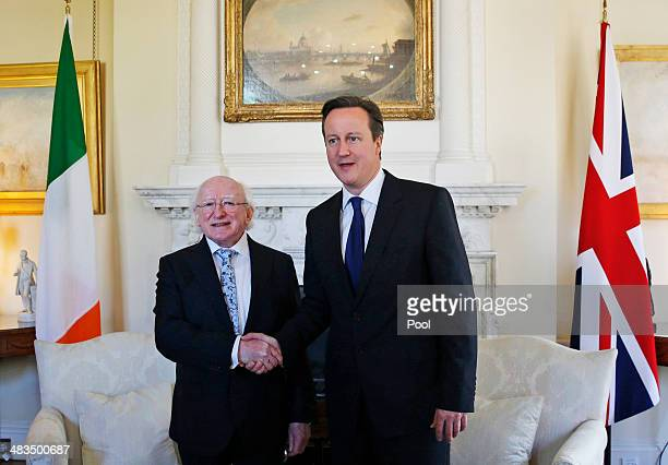 Irish President Michael D Higgins and British Prime Minster David Cameron shake hands during a meeting at 10 Downing Street on April 9 2014 in London...