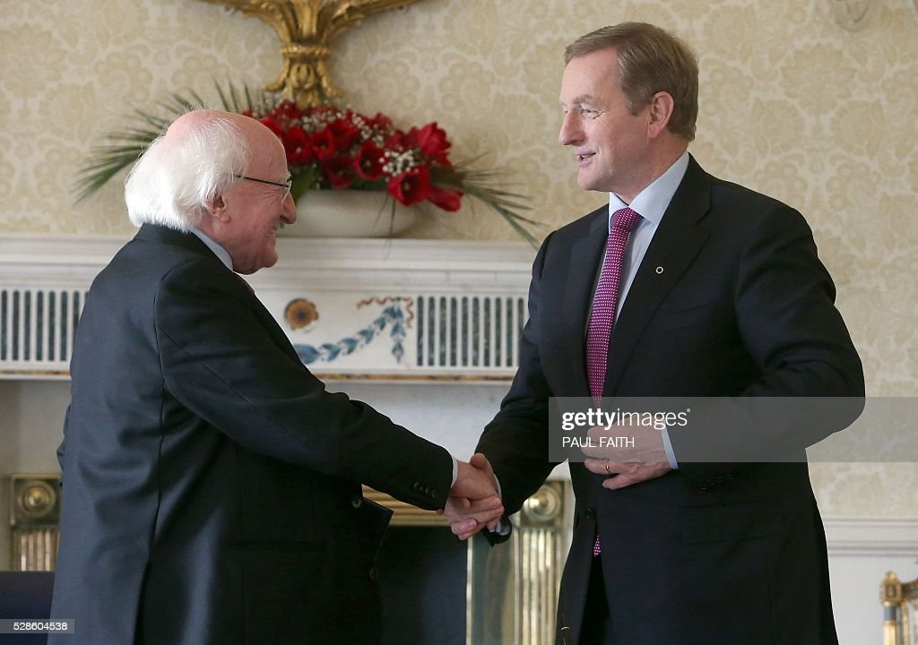 Irish President Michael D Higgins (L) greets re-elected Irish Prime Minister Enda Kenny in Dublin, Ireland, on May 6, 2016, after Kenny was officially re-appointed as Prime Minister for a second term. / AFP / Paul Faith