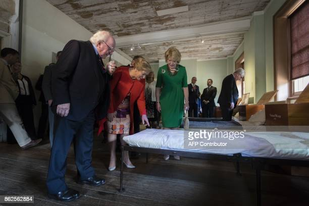 Irish President Michael D Higgins his wife Sabina and Ireland's Deputy Prime Minister Frances Fitzgerald inspect an exhibition dedicated to victims...