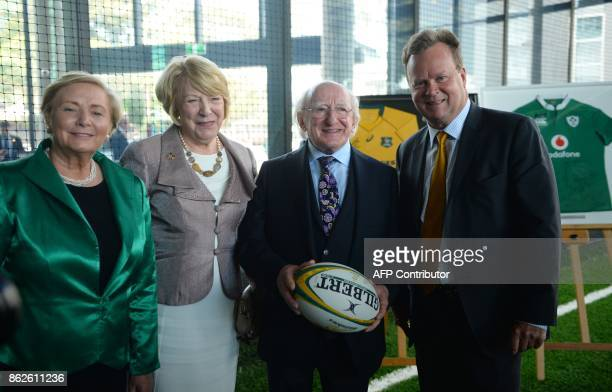 Irish President Michael D Higgins holds a rugby ball as he poses with his wife Sabina Australian Rugby Union CEO Bill Pulver and Ireland's Deputy...