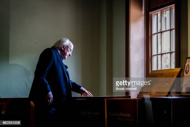 Irish President Michael D Higgins inspects an exhibition dedicated to the Irish Famine at the Hyde Park Barracks Museum on October 18 2017 in Sydney...
