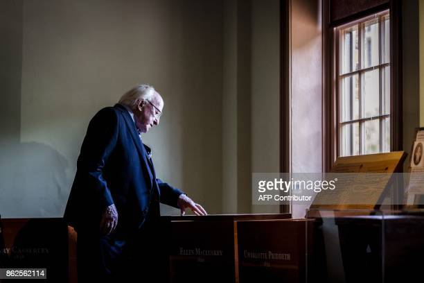 Irish President Michael D Higgins inspects an exhibition dedicated to victims of the Irish famine at Hyde Park Barracks Museum in Sydney on October...