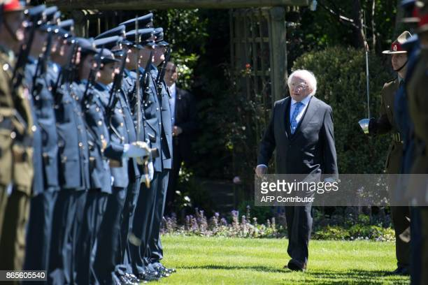 Irish President Michael D Higgins inspects the guard of Honour at Government House in Wellington on October 24 2017 Higgins is on a three day visit...