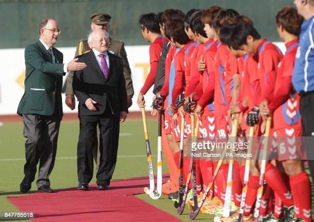 Irish President Michael D Higgins is introduced to the South Korean during their International Hockey Federation Olympic qualifing match at Belfield...