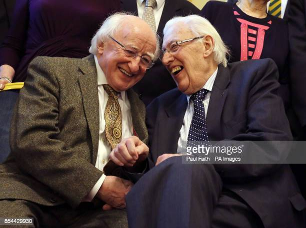 Irish President Michael D Higgins shares a joke with Ian Paisley former First Minister of Northern Ireland during a reception at Belfast City Hall to...