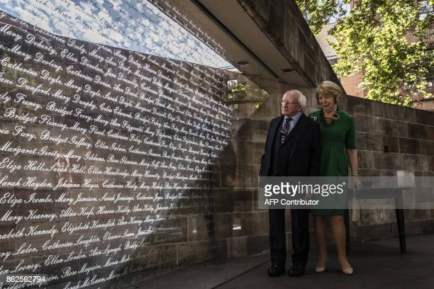 Irish President Michael D Higgins with his wife Sabina inspect an exhibition dedicated to victims of the Irish famine at Hyde Park Barracks Museum in...